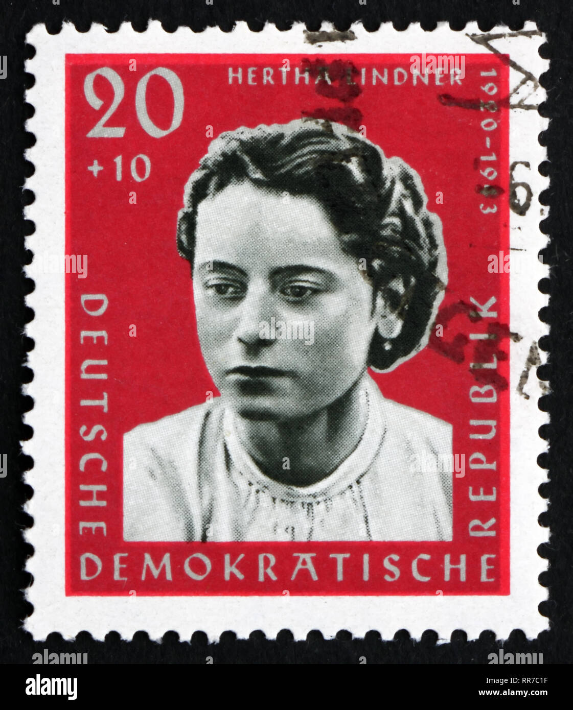 GDR - CIRCA 1961: a stamp printed in GDR shows Hertha Lindner, Resistance Fighter, circa 1961 Stock Photo