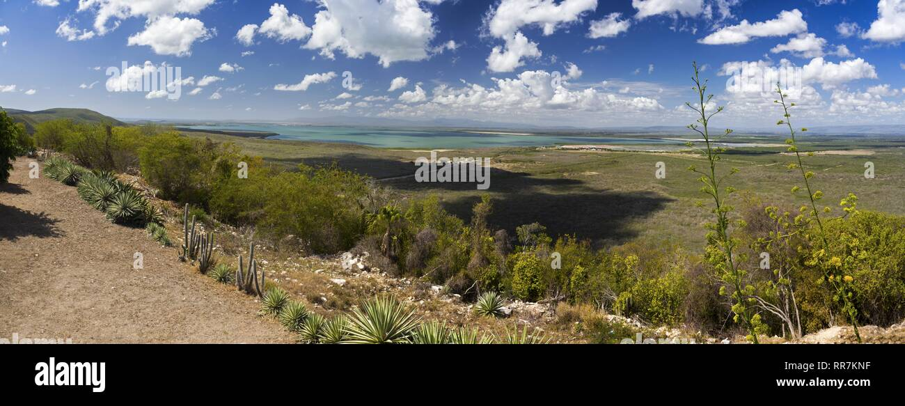 Wide Panoramic Landscape View of Guantanamo Bay, Cuba from Tourist Viewpoint above Cuban Military Base while US base is distant on the horizon - Stock Image