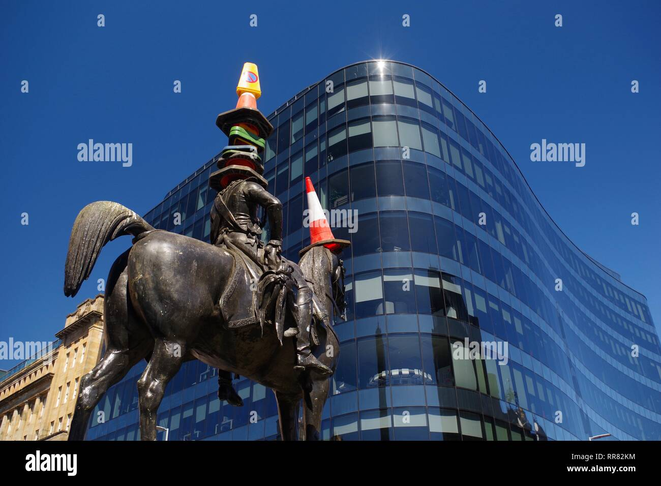 Equestrian statue of the Duke of Wellington, with Traffic Cones on Head.  Gallery of Modern Art, Glasgow, Scotland, UK. - Stock Image
