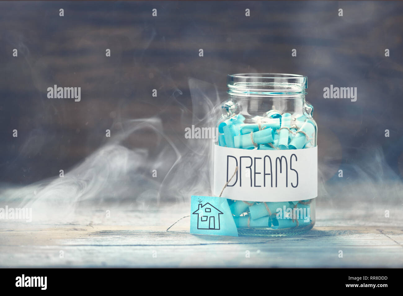 Dreams jar. Dream house concept. Full glass jar of cherished wishes Stock Photo