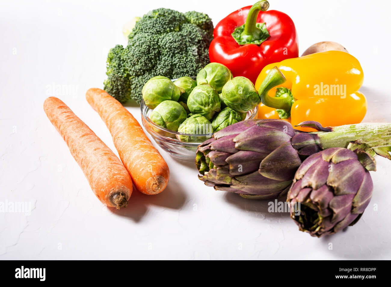 Background of healthy food and clean eating with fruit, vegetable, superfood, leaf vegetable. Soft focus. - Stock Image