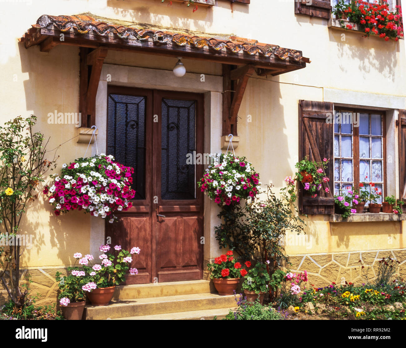 A terraced country cottage in the village of Termes d' Armagnac.Dept. of Gers. Southwest France. - Stock Image