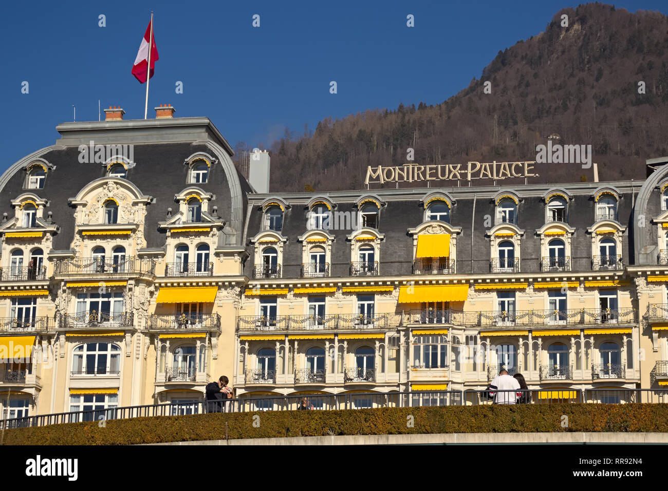 Montreux, Switzerland - 02 17, 2019: Montreux Palace Hotel, a five star luxury hotel with mountains in the background. - Stock Image