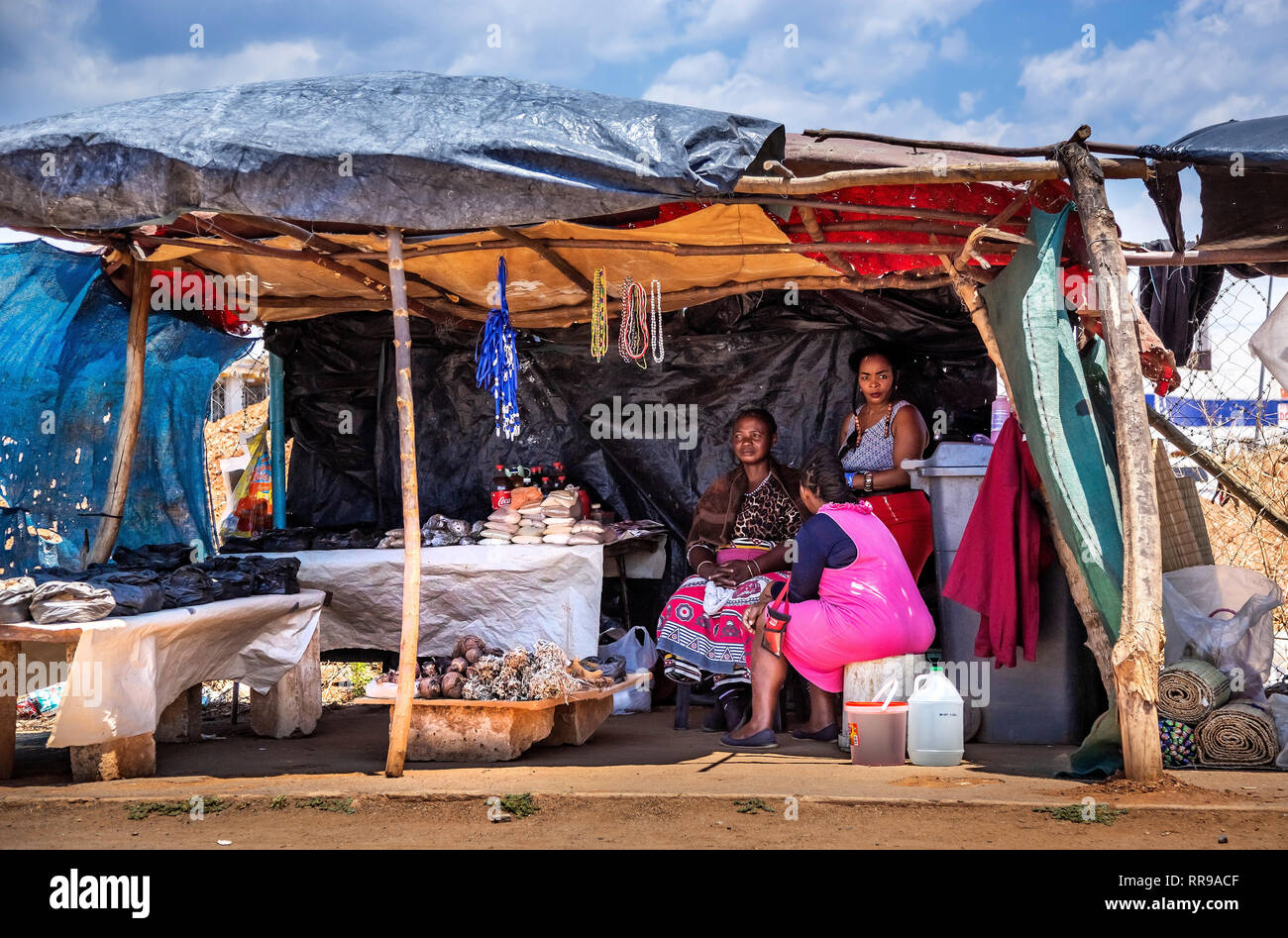 Johannesburg, South Africa, 9 November - 2018: Hawker stall with ladies selling local cures for common ailments, on the side of the road. - Stock Image