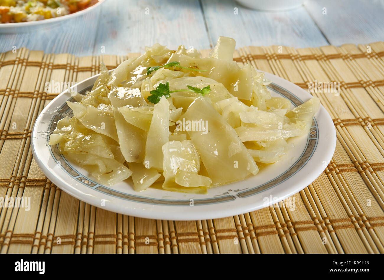 Bayrisch Kraut - Bavarian cabbage, shredded cabbage that is cooked in beef stock with pork lard, onion, apples, and seasoned with vinegar - Stock Image