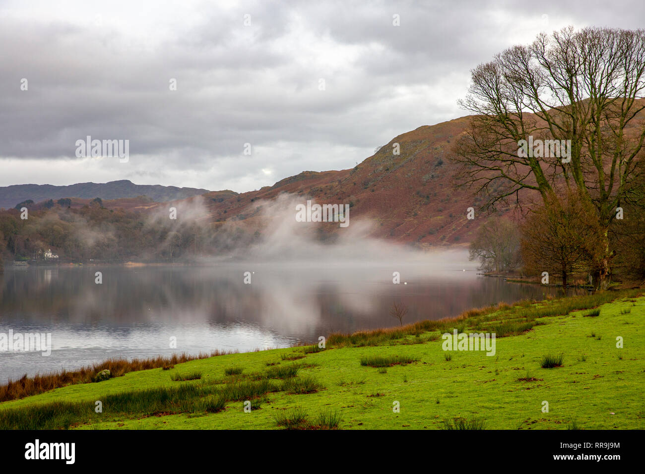 Early morning mist above Grasmere Lake, Grasmere in the Lake District national park,Cumbria,England Stock Photo