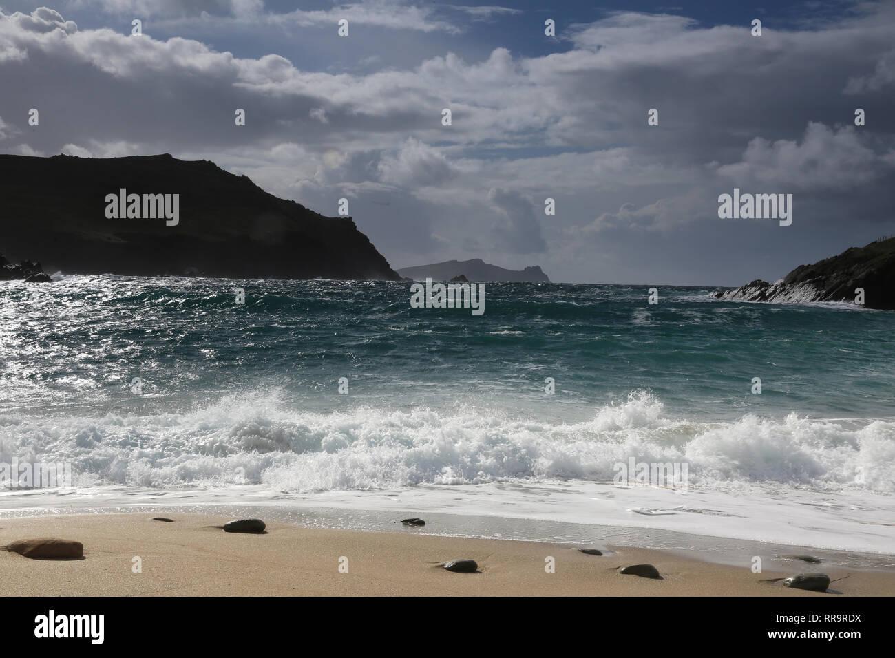 atlantic waves crashing onto narrow sea inlet, wild atlantic way, county kerry, ireland - Stock Image
