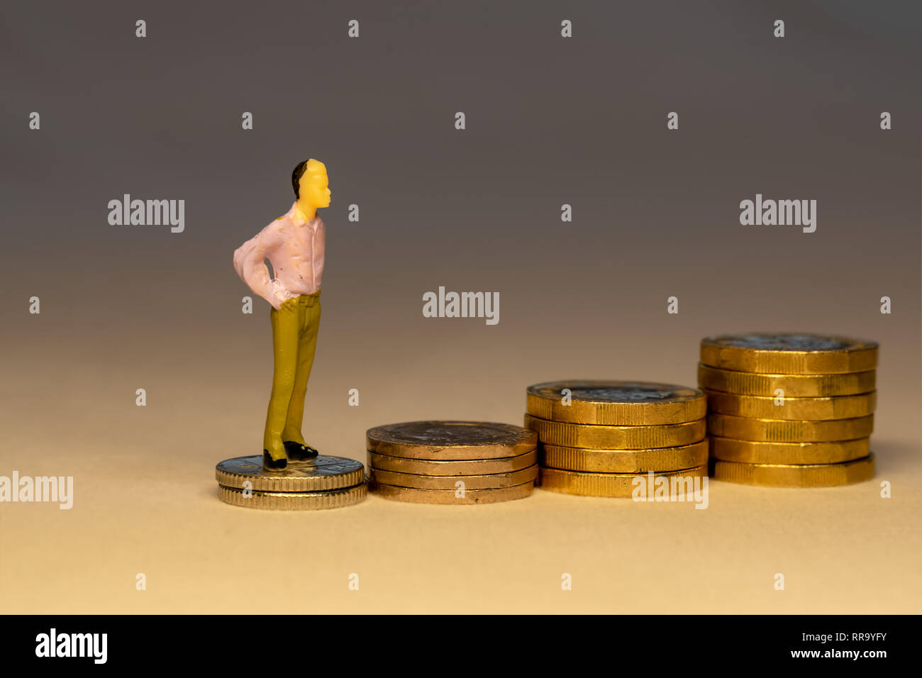 Man climbing on increasing piles of gold coins. Saving money for retirement, business career or investment concept. - Stock Image