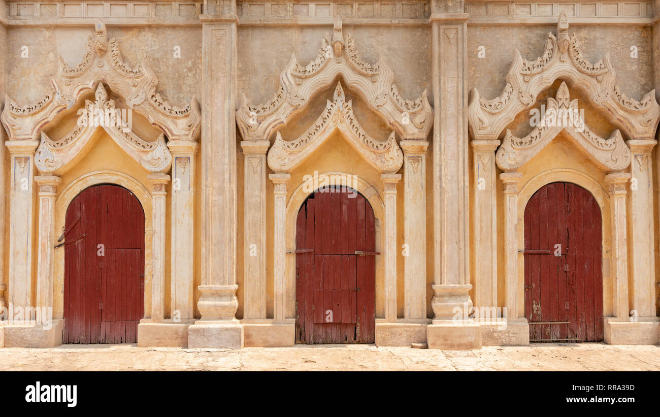 Three red doors in a row at a temple, Bagan, Myanmar - Stock Image