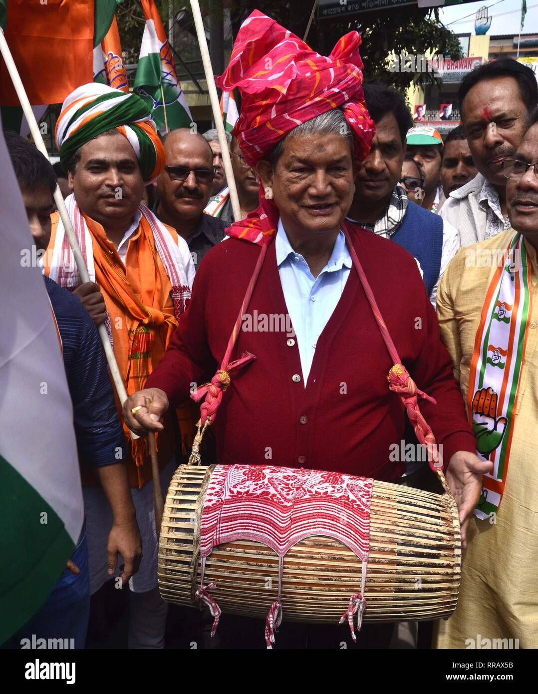 Guwahati, Assam, India. 25th Feb, 2019. Congress General Secretary Harish Rawat beating a Assamese Traditional Dhol(Drum) during flagged off Prachar Yatra for publicity of Congress President Rahul Gandhi's Rally in Guwahati on Monday, 25 February 2019. Credit: Hafiz Ahmed/Alamy Live News Stock Photo
