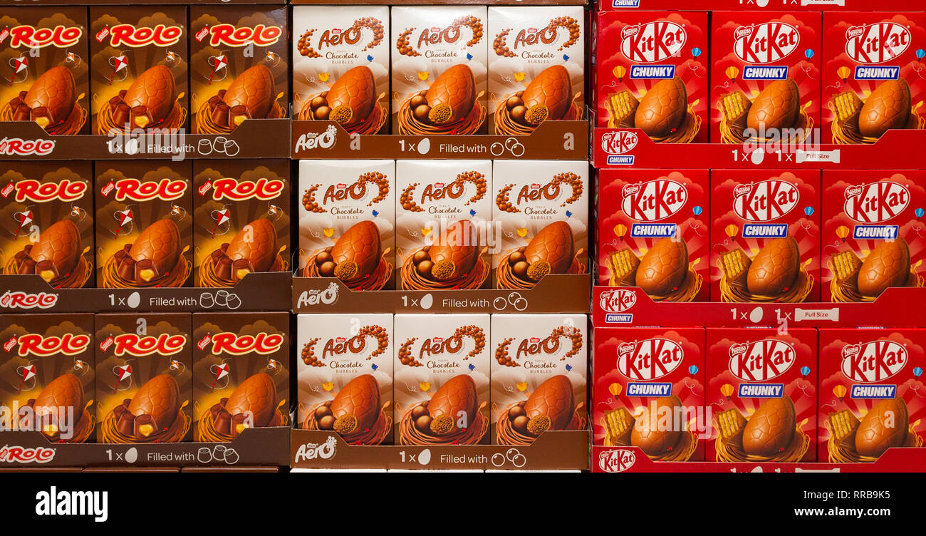 Boxes of Nestlé Rolo Aero KitKat chocolate Easter Eggs. - Stock Image