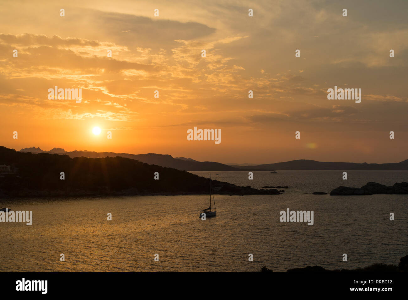 Colourful Golden Sunset View: Coastline of Northern Sardinia and the Islands of La Maddalena With Vivid Red Sky. - Stock Image