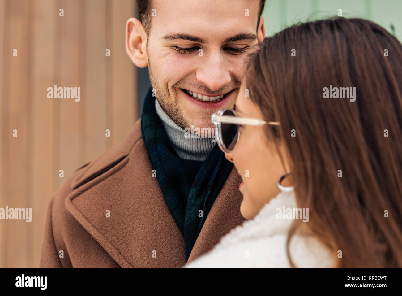 Handsome man falling in love with his appealing girlfriend - Stock Image