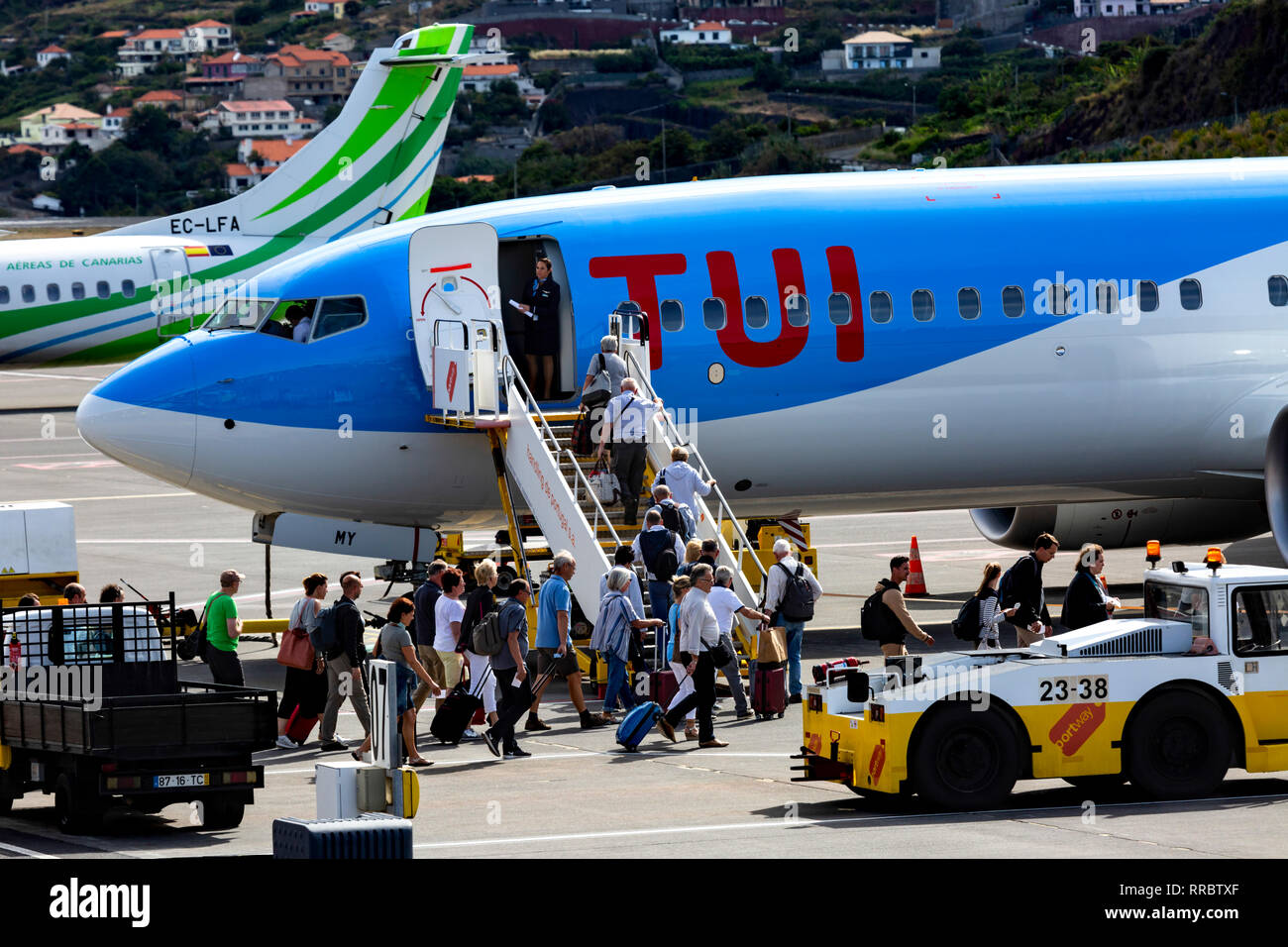 Passengers boarding a TUI Boeing 737 at Cristiano Ronaldo (Funchal) Airport, Madeira, Portugal. - Stock Image