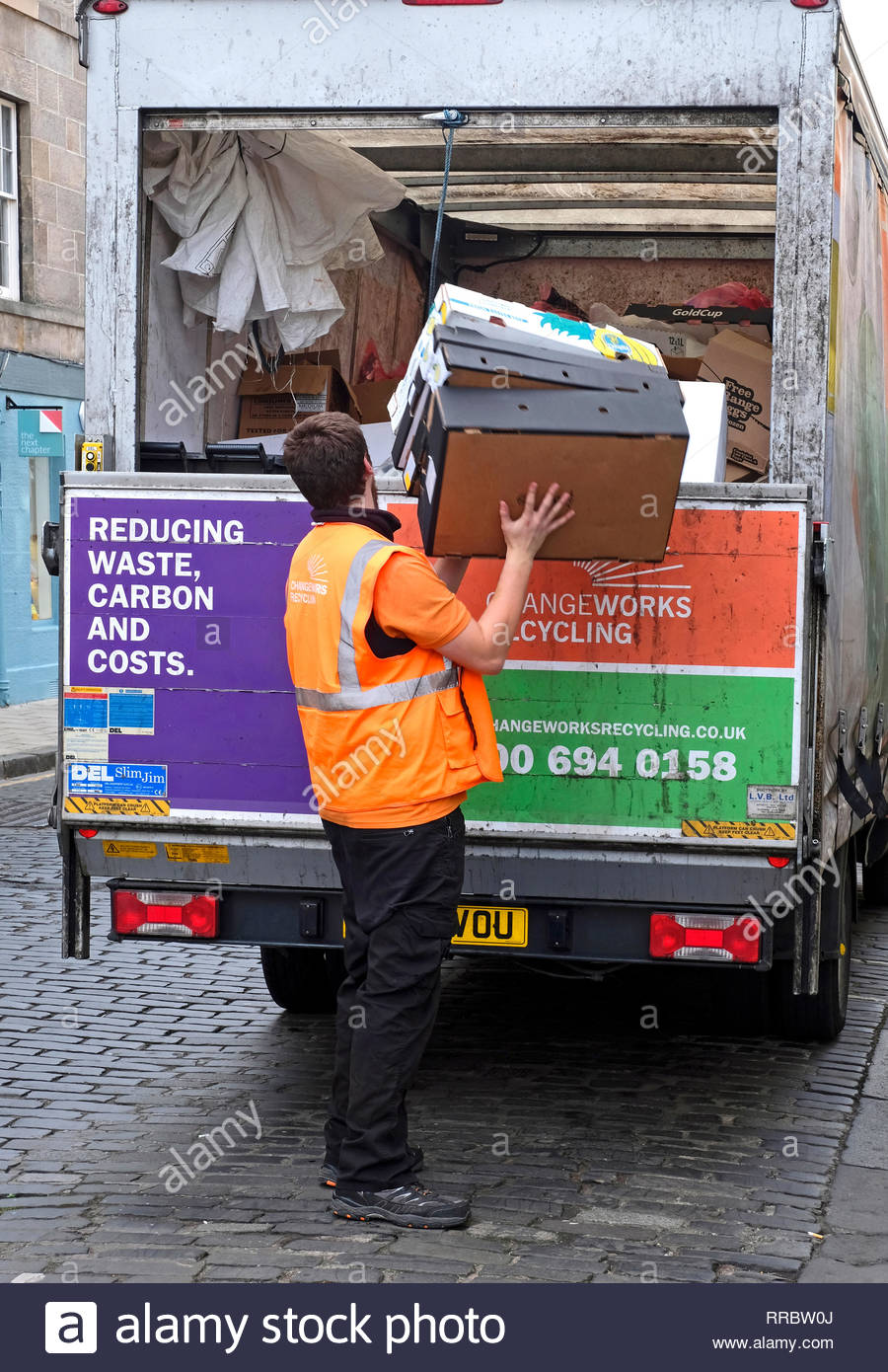 f90a298310 Cardboard packaging being collected and loaded onto a lorry for recycling -  Stock Image