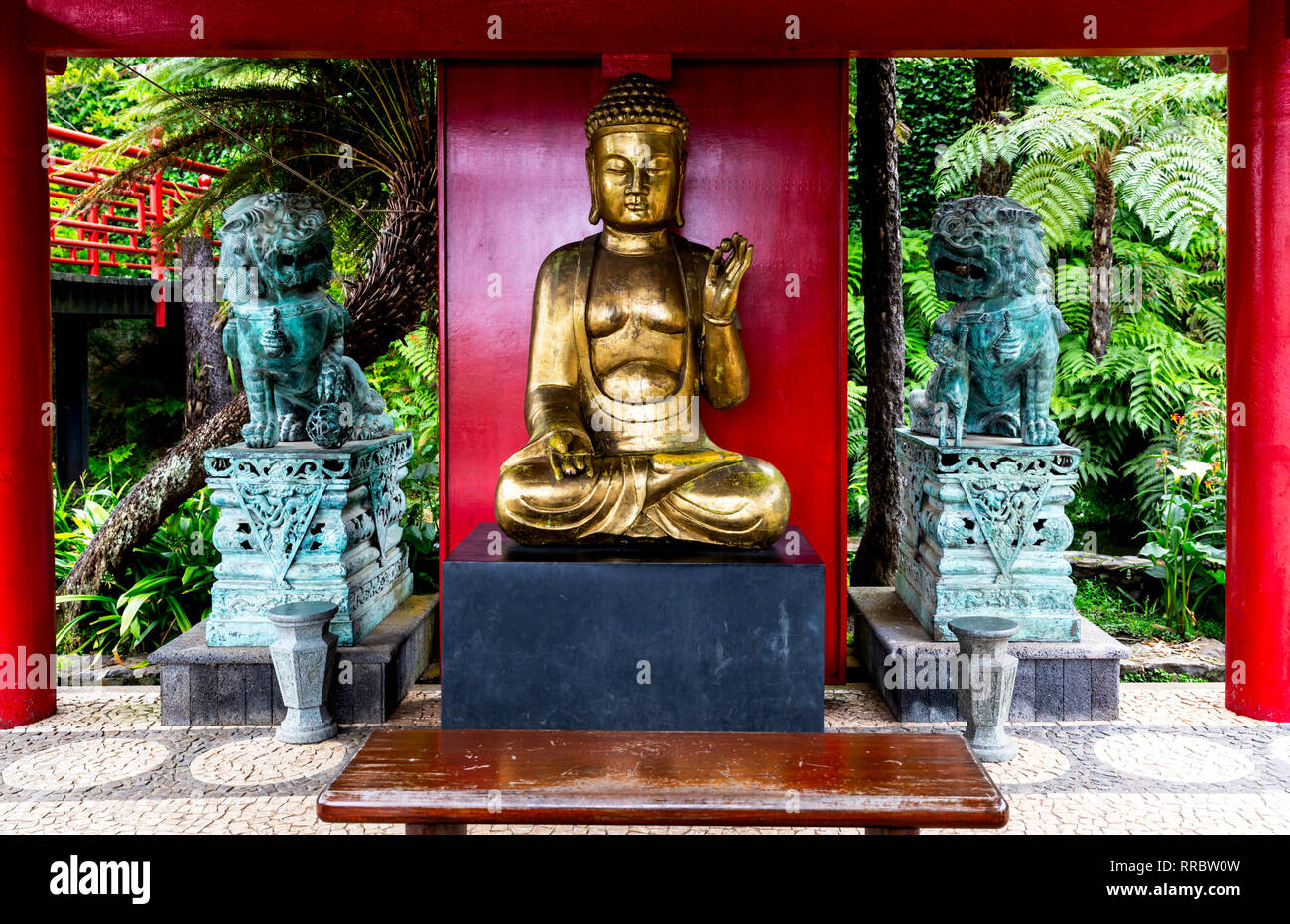 Golden Buddha statue in the Japanese garden, Monte Palace Tropical Gardens, Funchal, Madeira, Portugal. Stock Photo