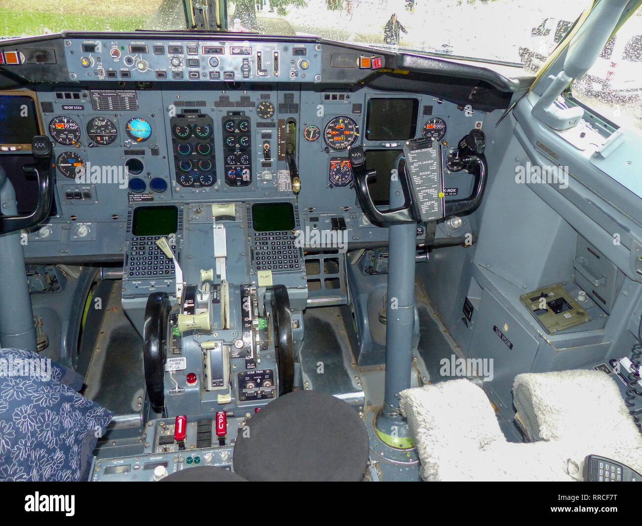 Interior of a cockpit with flight control gauges and controls - Stock Image