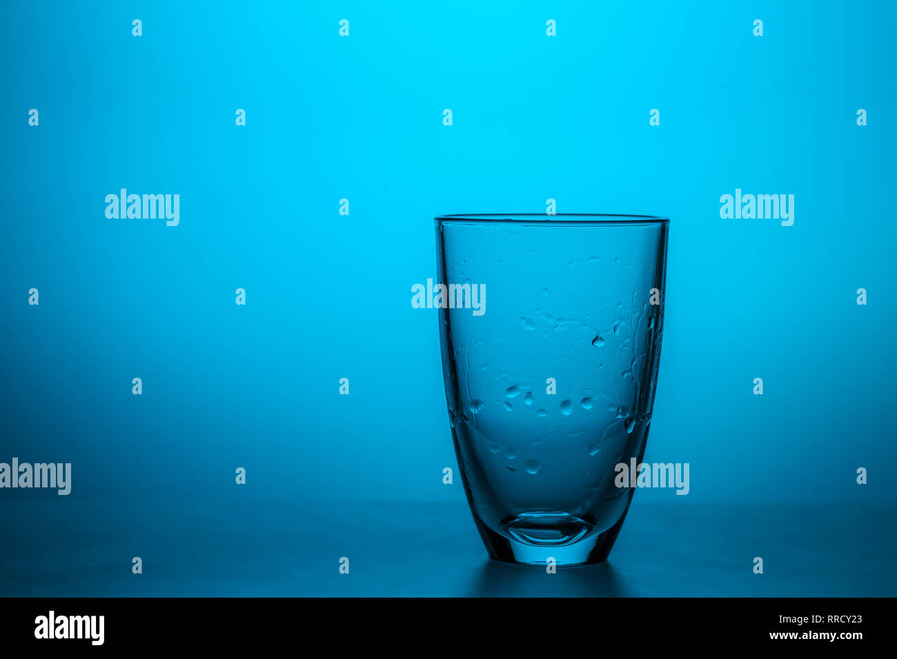 Transparent glass with water drops - Stock Image