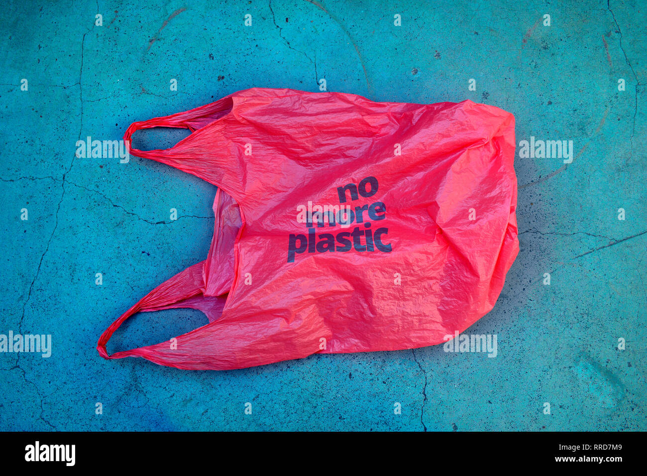 No plastic. Environmental awareness vindication shot. It shows a red plastic bag garbage with motto no more plastic. - Stock Image
