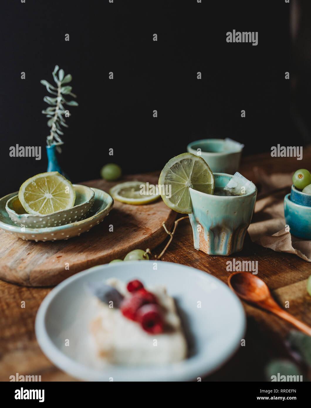 Arrangement of ceramic utensil on wood table - Stock Image