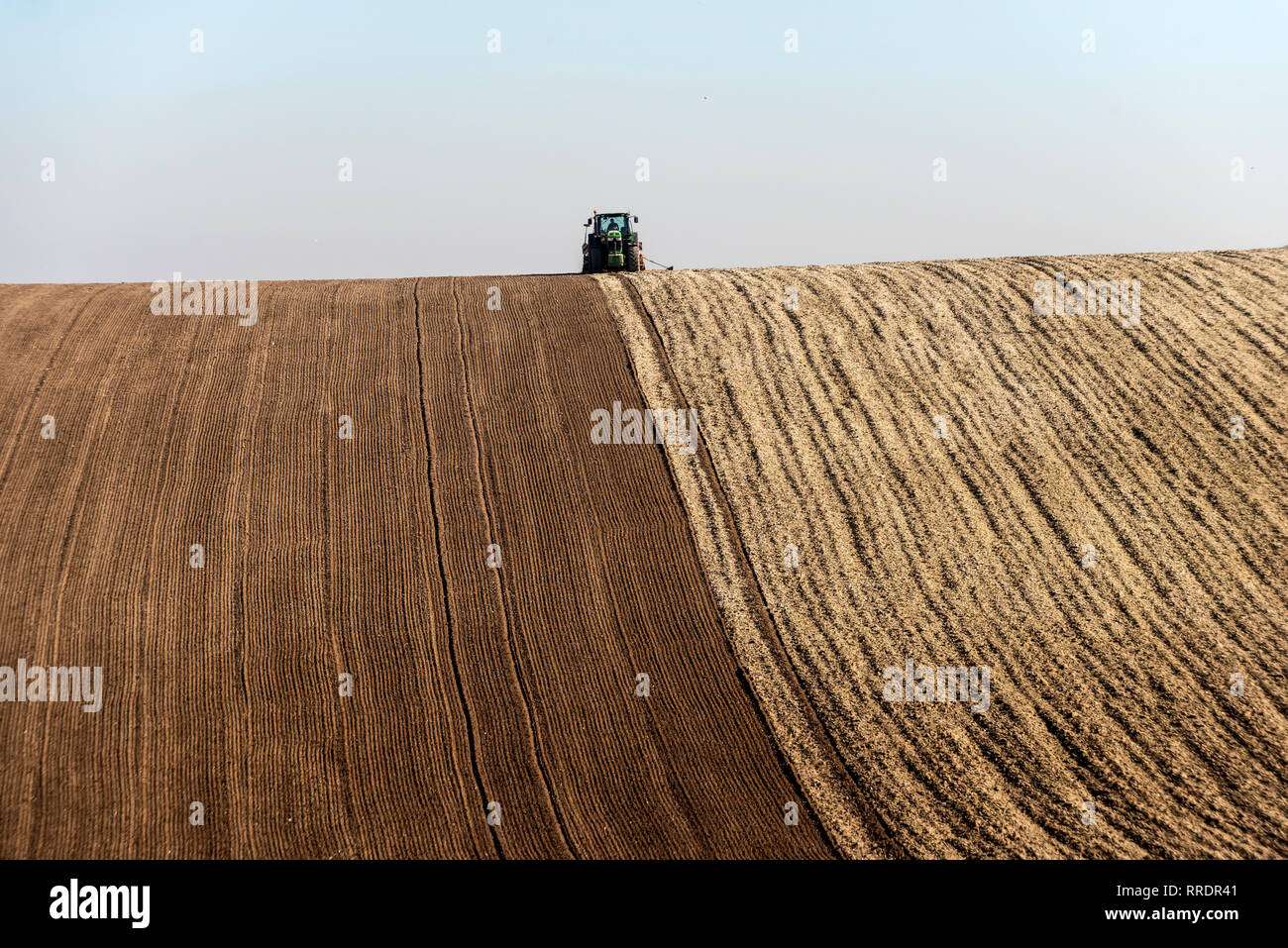BRIGHTON, ENGLAND - FEBRUARY 25: A farmer preparing his fields for the spring at Falmer, near Brighton, England. (Photo by Andrew Hasson/Getty Images) - Stock Image