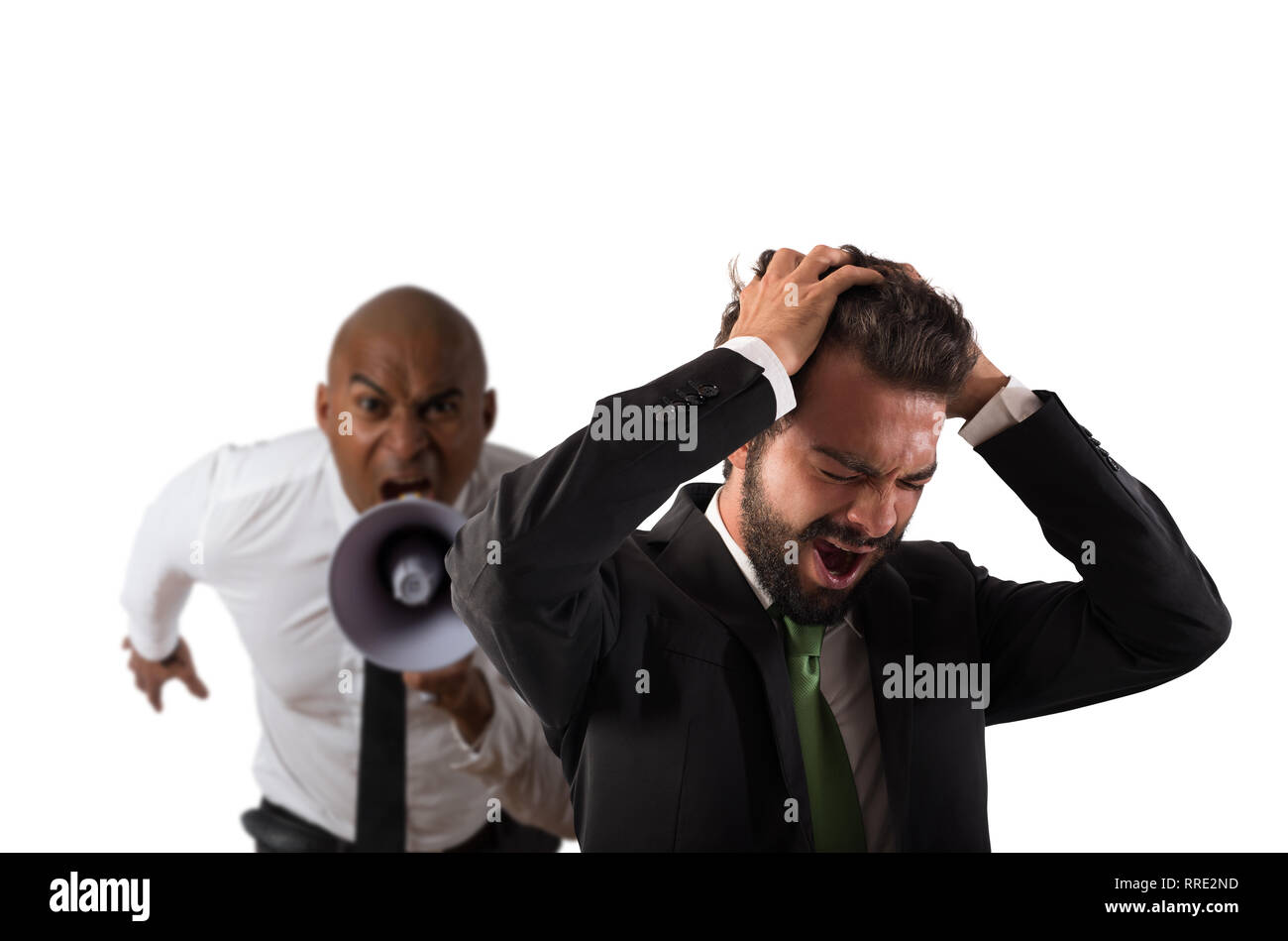 Boss scolds with megaphone a desperate employee with a verbal aggression - Stock Image