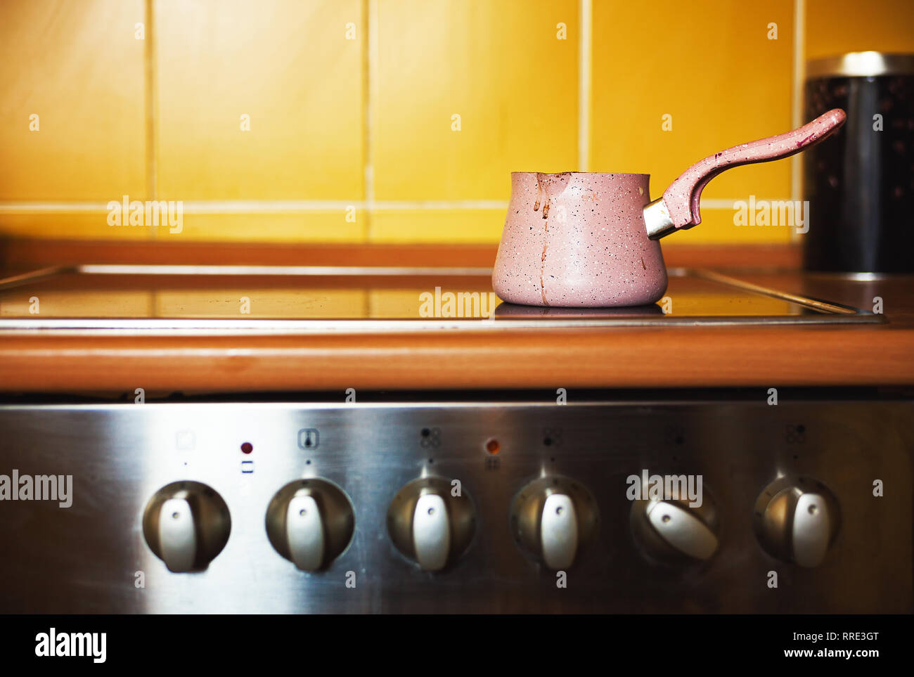 One coffee pot on kitchen stove, ordinary lifestyle scene. - Stock Image
