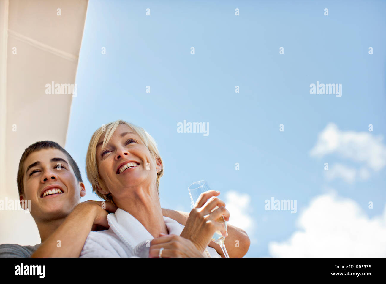Mother and son standing on deck of cruise ship. Stock Photo