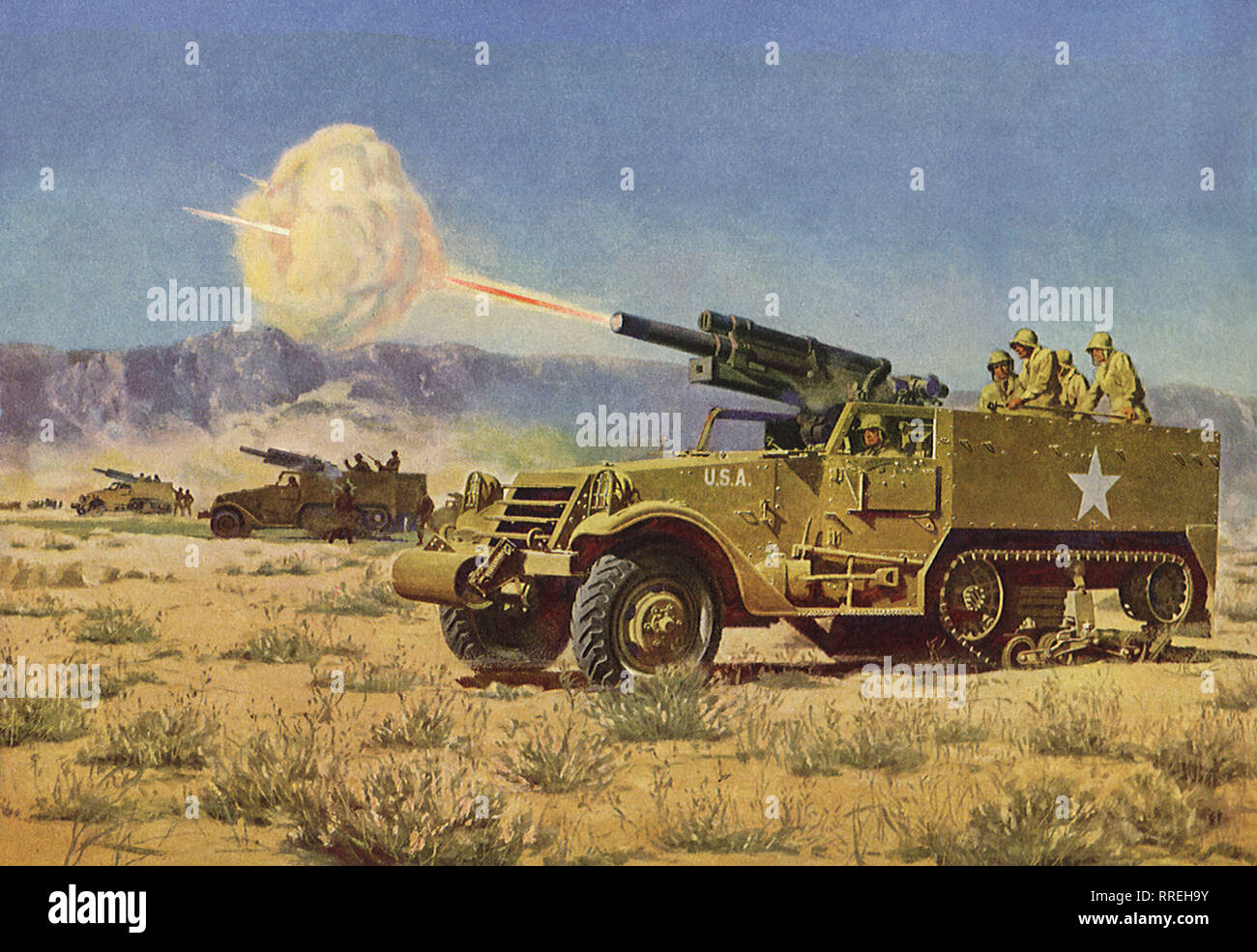 Truck tank shooting artillary gun in the field. - Stock Image