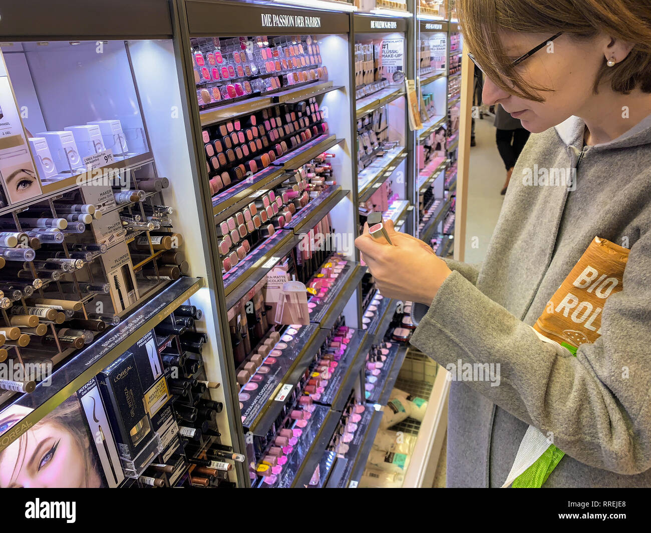 MUNICH, GERMANY   OCT 20, 20 Side view of woman buying in ...