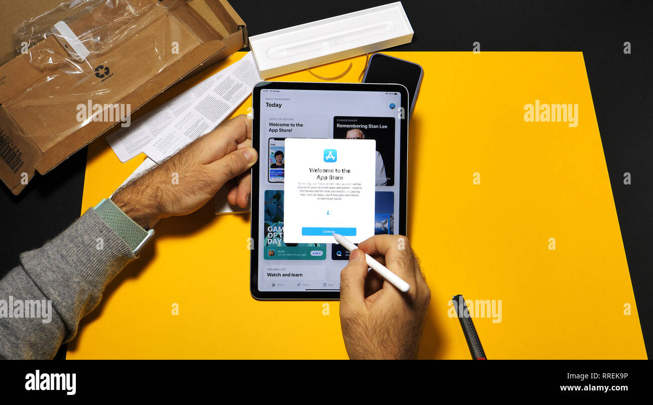 PARIS, FRANCE - NOV 16, 2018: Welcome to the app store message on latest iPad Pro by Apple Computers working testing the latest Apple Pencil 2 on office yellwo table - Stock Image
