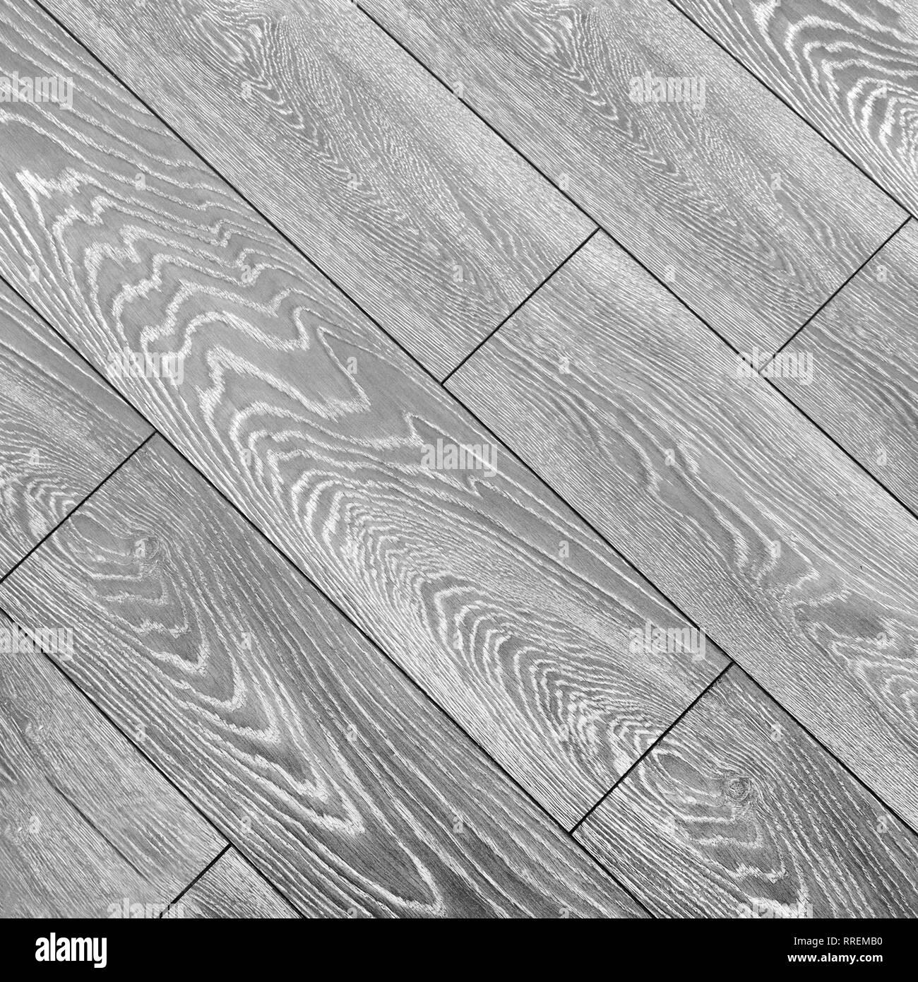 Stylish gray laminate flooring with strong natural wood pattern - Stock Image
