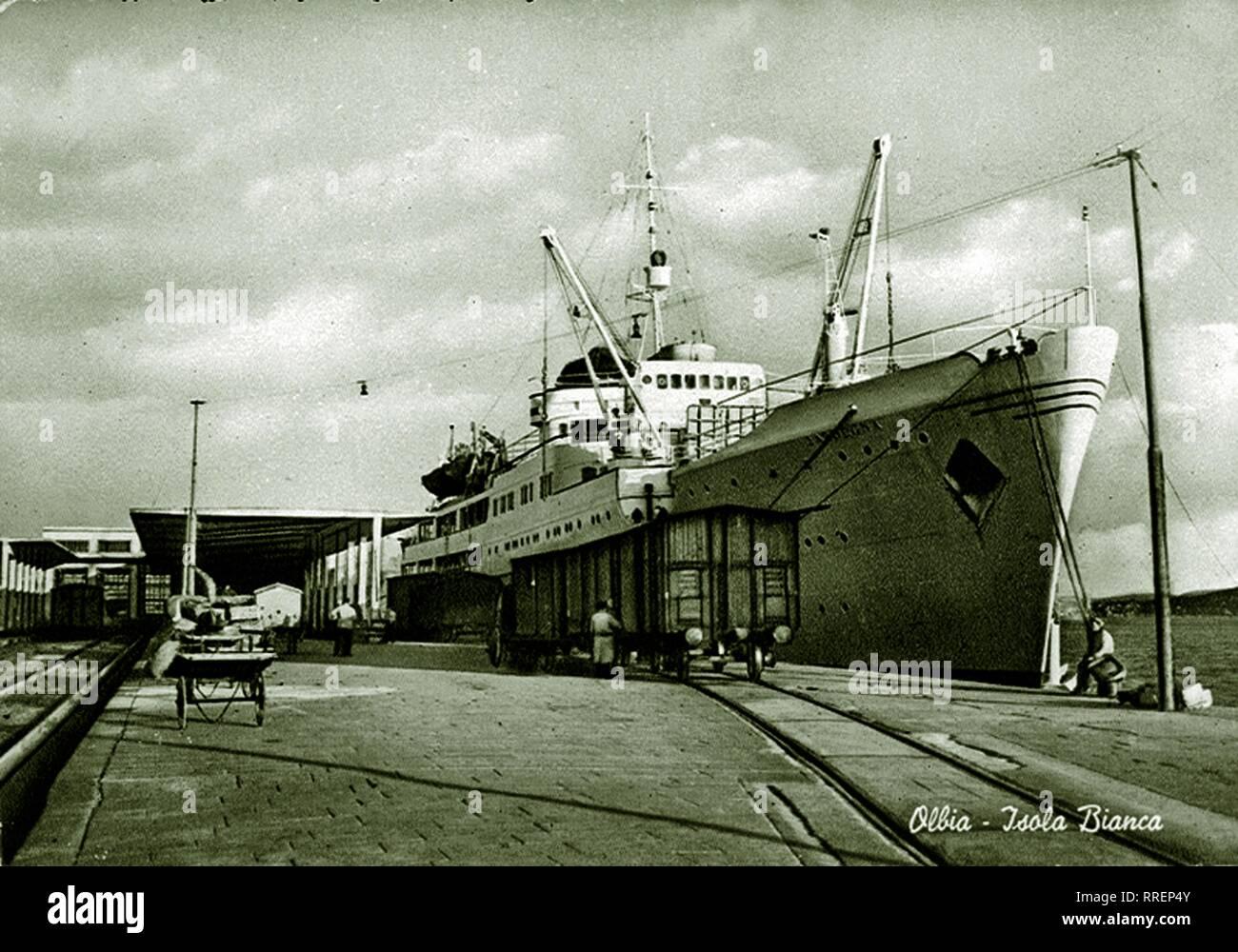 Historical postcard. Olbia, Sardinia, Italy. The Isola Bianca harbour 1960 asbut - Stock Image
