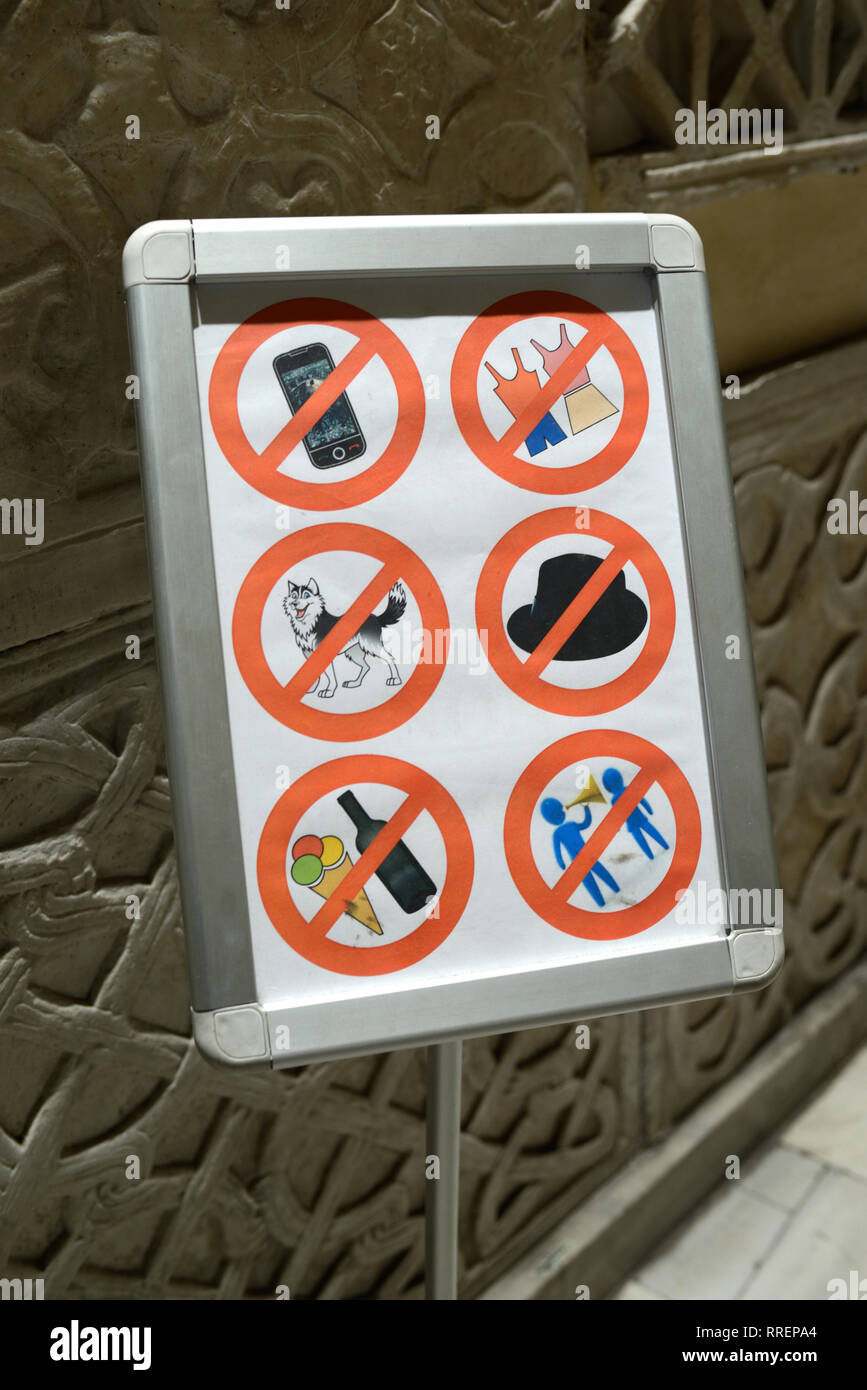 Forbidden Sign Imposing Dress Code & Restrictions Sign Restricting Access to the Church or Basilica of Santa Maria in Trastevere Rome Italy - Stock Image