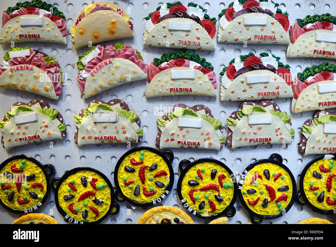 Souvenir Fridge Magnets of Italian Food Dishes including Piadina Flatbread Sandwiches, Frittata Omelettes & Pizza For Sale in Gift Shop Rome Italy - Stock Image