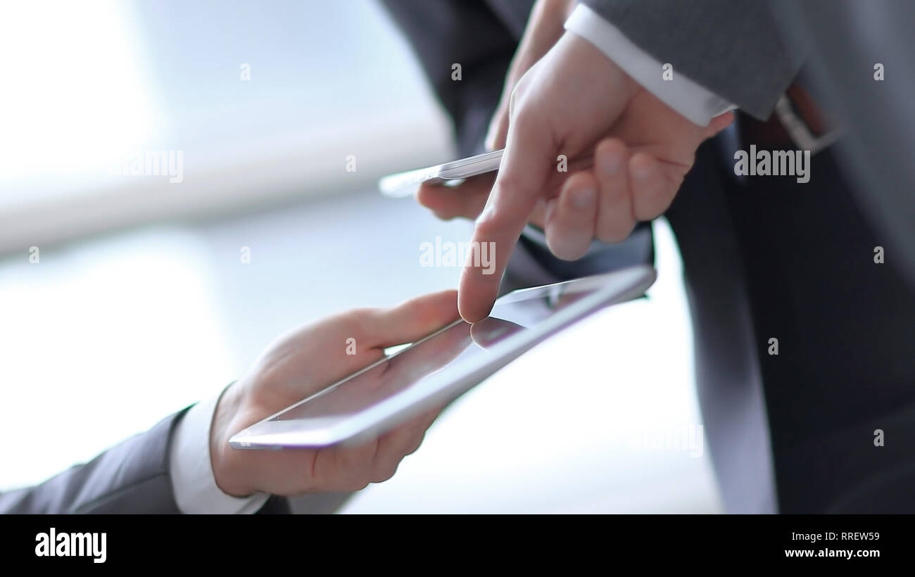 Hands of people working with tablet computer. Technology - Stock Image