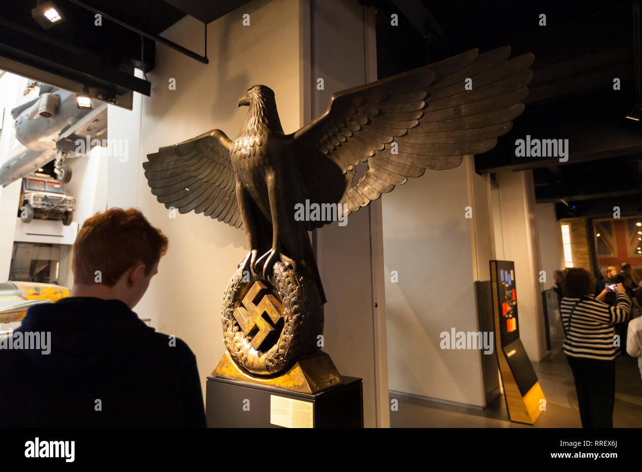 Bronze eagle clutching a swastika in its talons made for the Reich Chancellery built in 1939. Imperial war museum, london, uk - Stock Image