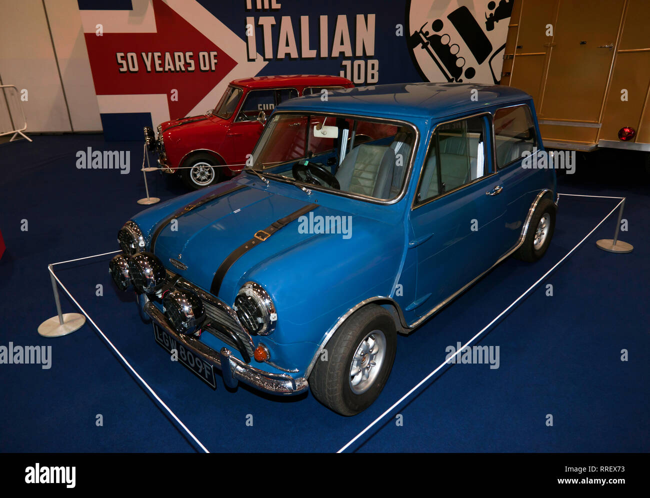 Front view of a Red and Blue Mini, as used in the heist section of The Italian Job in a special tribute exhibition at the 2019 London Classic Car Show - Stock Image