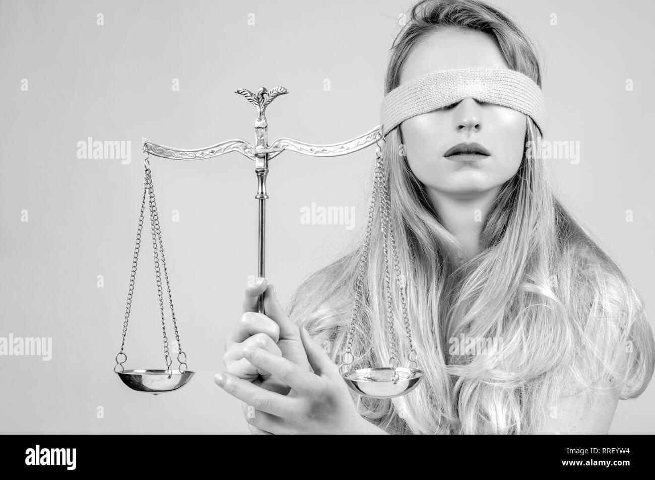 Femida, Goddess of Justice with scales wearing blindfold - Stock Image
