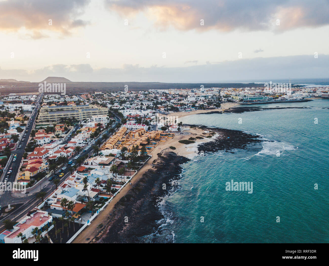 Scenic aerial view of city on ocean shore - Stock Image