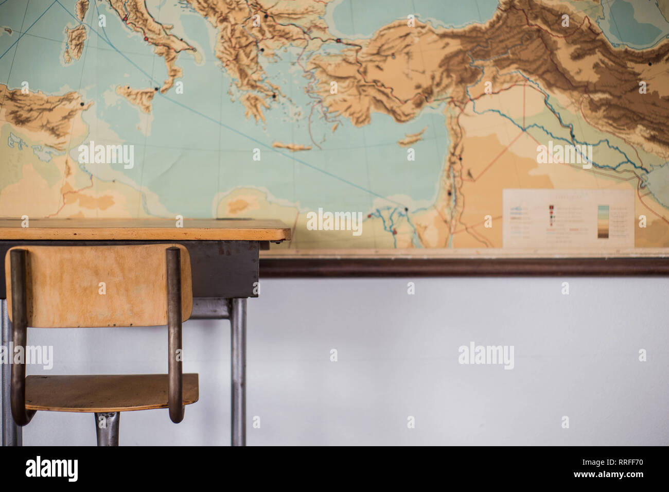 Empty desks at school clroom with world map Stock Photo ... on