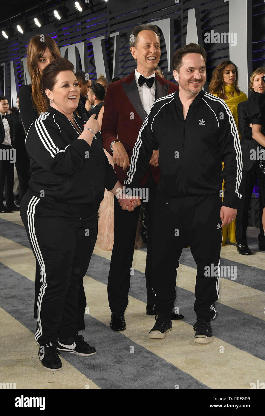 February 24, 2019 - Los Angeles, California, U.S. - 24 February 2019 - Los Angeles, California - Melissa McCarthy, Richard E. Grant, Ben Falcone. 2019 Vanity Fair Oscar Party following the 91st Academy Awards held at the Wallis Annenberg Center for the Performing Arts. Photo Credit: Birdie Thompson/AdMedia (Credit Image: © Birdie Thompson/AdMedia via ZUMA Wire) - Stock Image