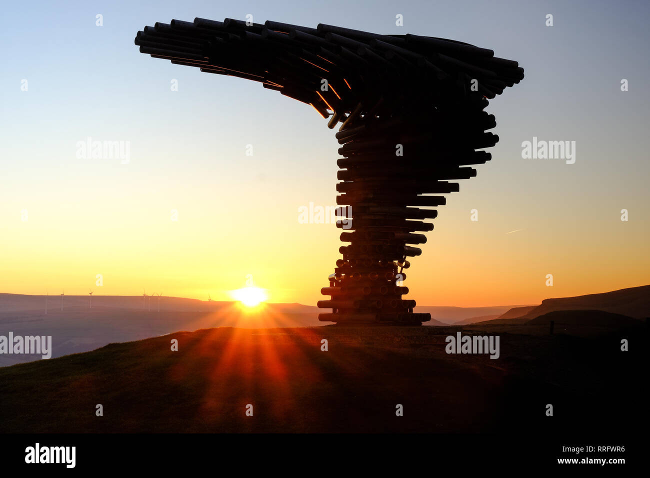 Burnley, UK. 26th February 2019. UK Weather. There was a stunning sunrise at The Singing Ringing Tree near Burley in Lancashire as the fine February weather continued. The Singing Ringing Tree is a wind powered sound sculpture resembling a tree set in the landscape of the Pennine hill range overlooking Burnley, in Lancashire. Burnley's Panopticon, 'Singing Ringing Tree', is a unique musical sculpture which overlooks Burnley from its position high above the town on Crown Point. Credit: Paul Melling/Alamy Live News - Stock Image