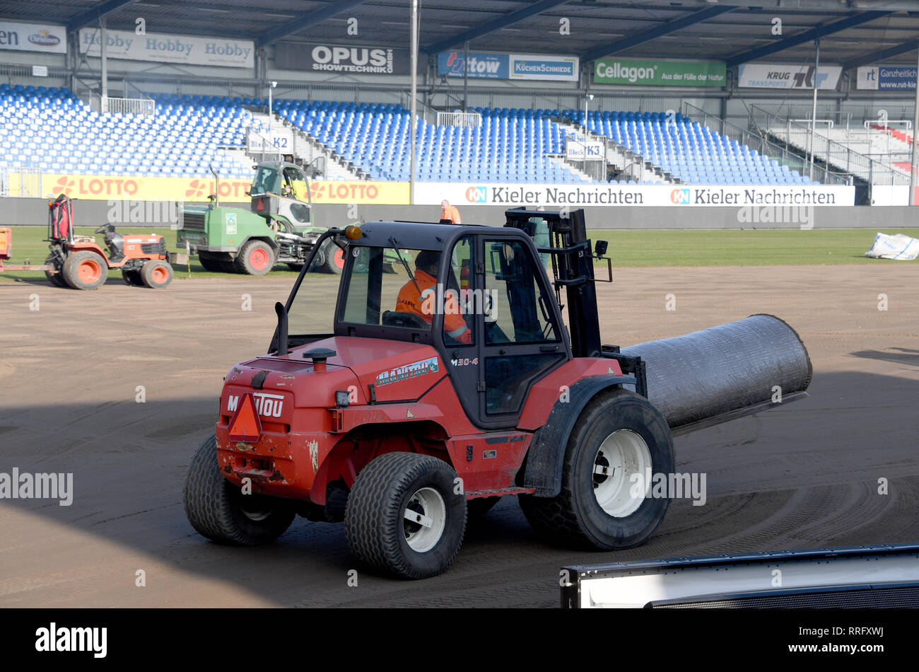 26 February 2019, Schleswig-Holstein, Kiel: Around 8000 square meters of new grass will be laid in the Holstein Stadium in Kiel. The 290 reels cost an almost six-figure sum. The last time the lawn was changed was about a year ago. Holstein Kiel plays here on 01.03.2019 against Union Berlin Photo: Carsten Rehder/dpa - IMPORTANT NOTE: In accordance with the requirements of the DFL Deutsche Fußball Liga or the DFB Deutscher Fußball-Bund, it is prohibited to use or have used photographs taken in the stadium and/or the match in the form of sequence images and/or video-like photo sequences. Stock Photo