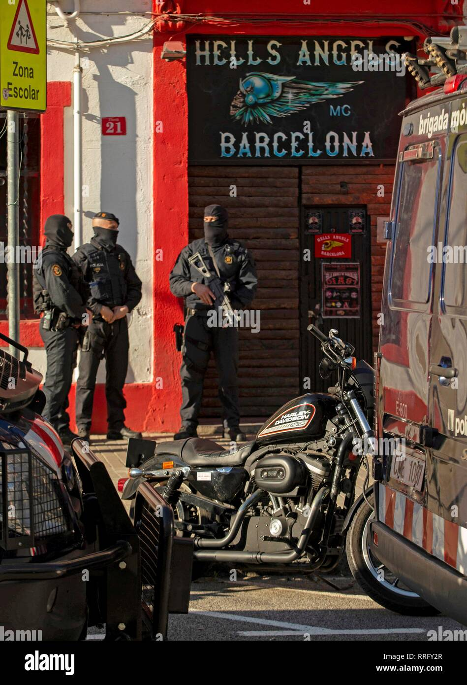Catalan Mossos d Esquadra policemen keep watch during a search at one of  the premises of the Hells Angels motorcycle club in Barcelona f24184a5d54