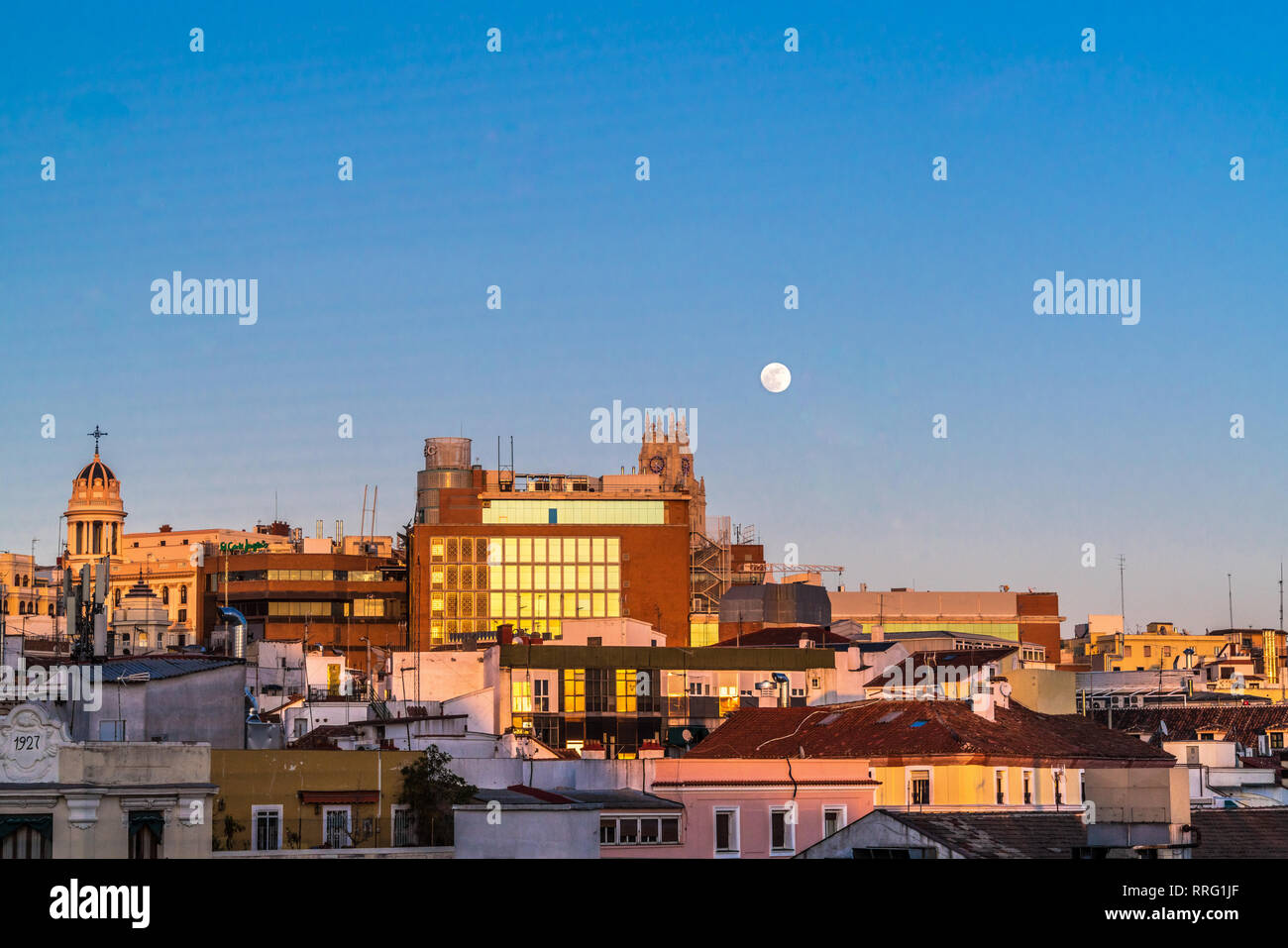 Madrid, Spain - January 31, 2018 : Super blue blood moon incredibly rare phenomenon view over downtown old historic Madrid center skyline during sunse - Stock Image