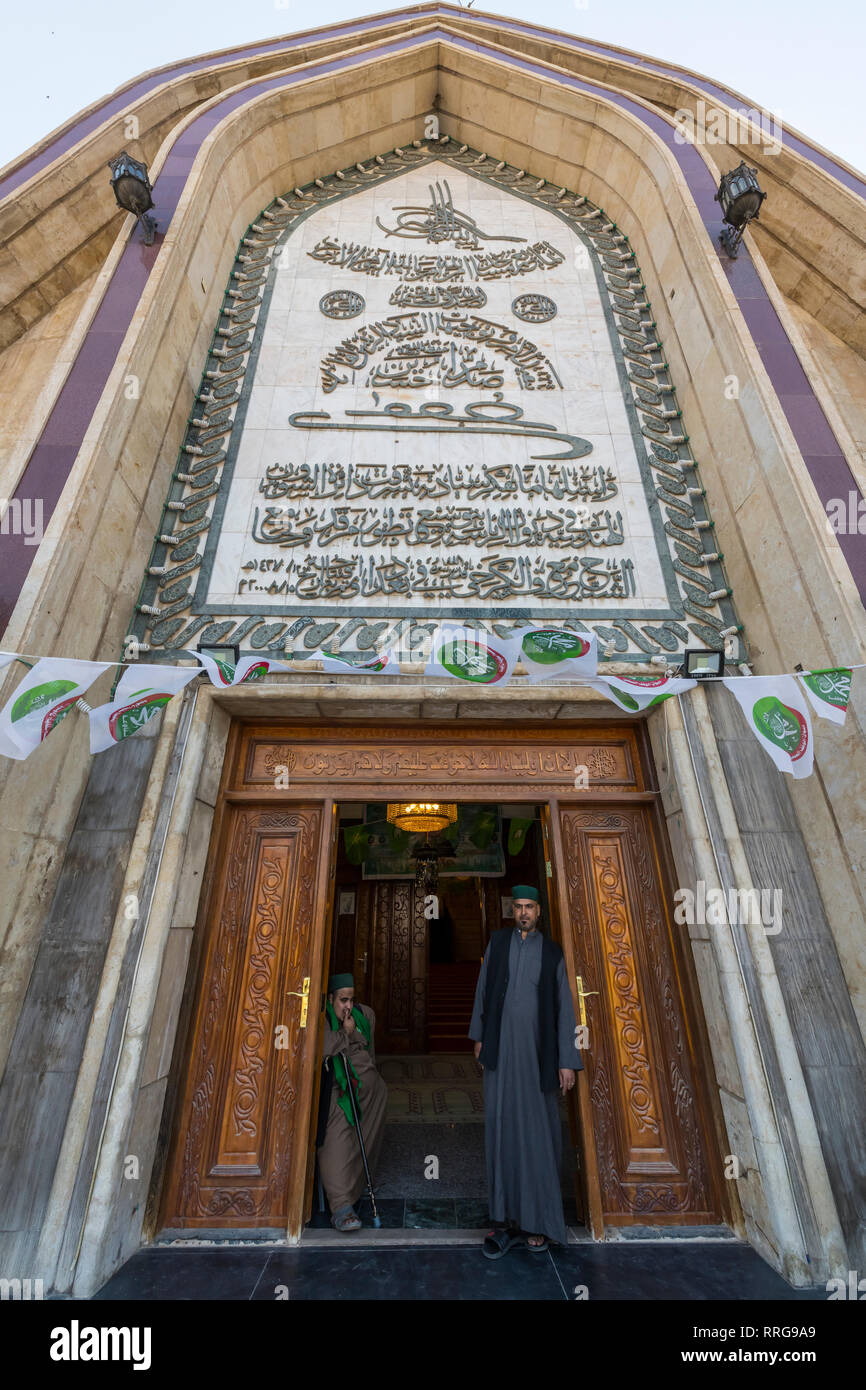 Sufi men standing in the Maruf al-Karkhi Sufi Mosque, Baghdad, Iraq, Middle East - Stock Image