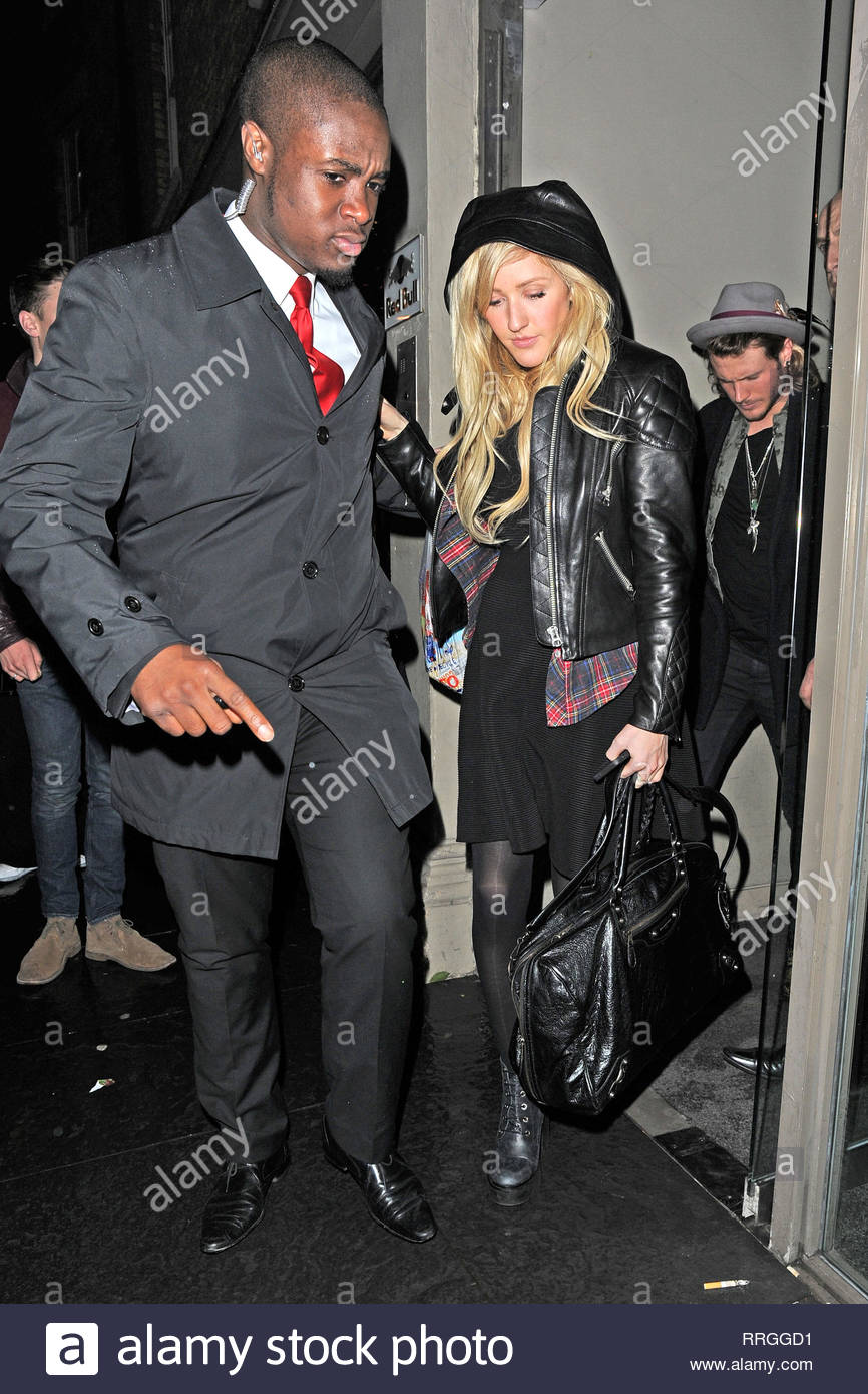 **USA ONLY** London, UK - Ellie Goulding receives a security escort as she  departs the Storm Management London Fashion Week party at Red Bull Studios  in ...
