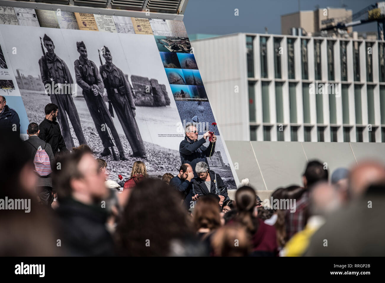 A man seen taking a pic of the event during the tribute. Inauguration of the memorial space of the Camp de la Bota in memory of the 1,706 people shot by the Franco regime between 1939 and 1952. - Stock Image