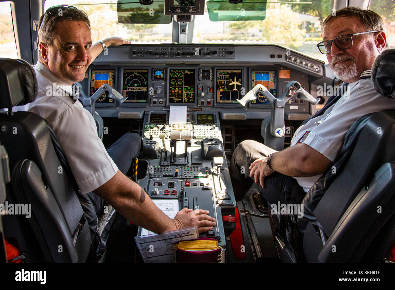 Pilot and Copilot in Cockpit on Ground - Stock Image